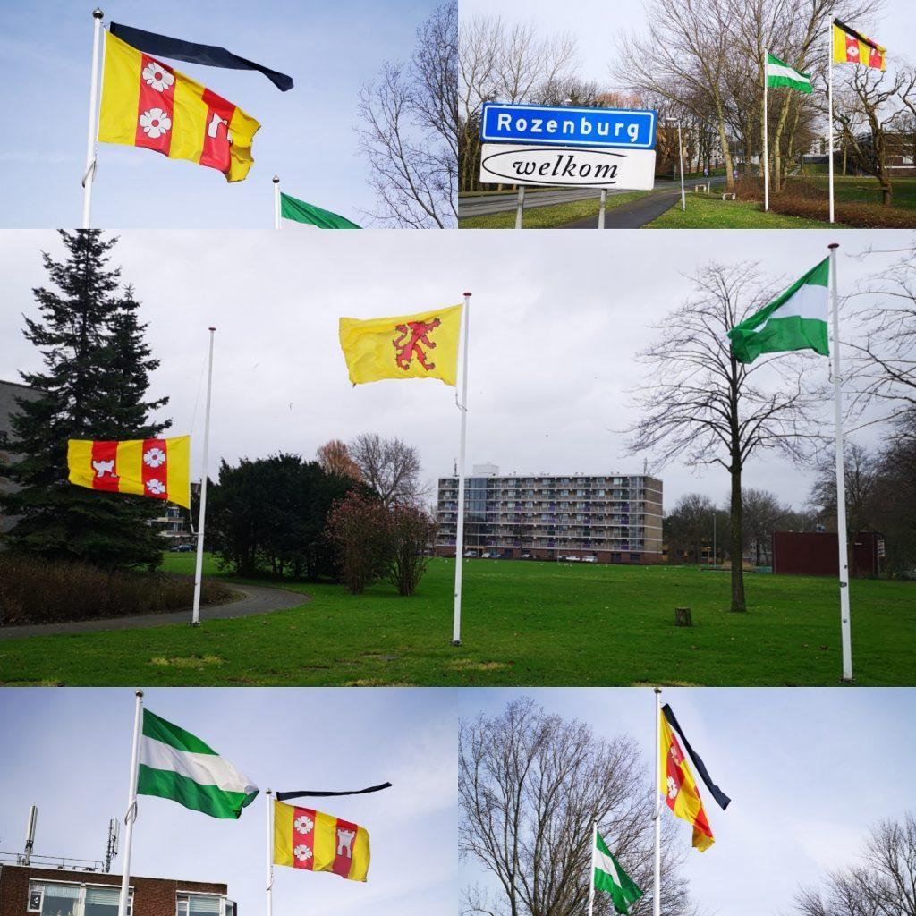 Vlaggen in Rozenburg met rouwwimpel en halfstok.